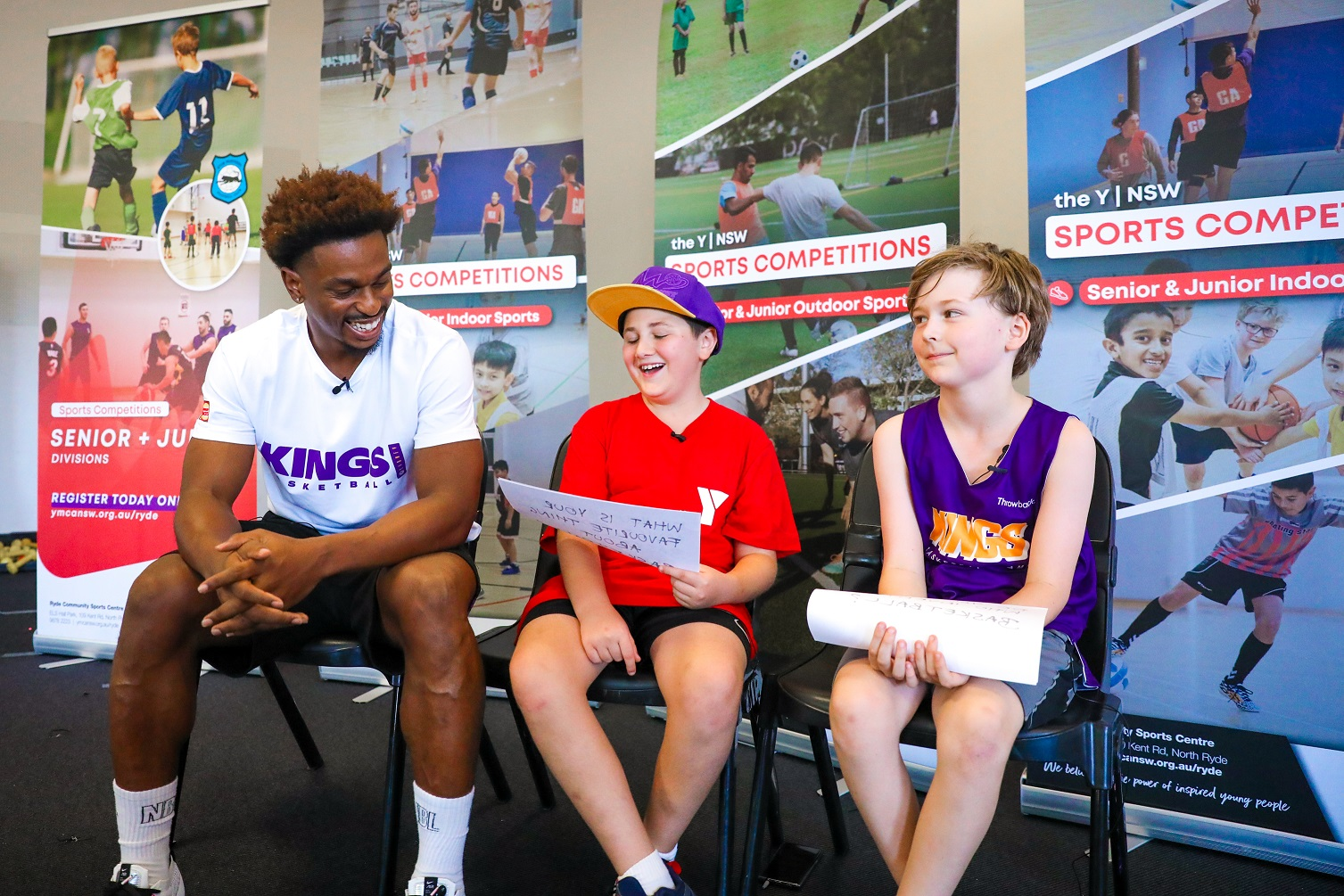 Sydney Kings player Casper Ware being interviewed by Y NSW young basketballers Jacob Laface and Will Harris (both year 4)